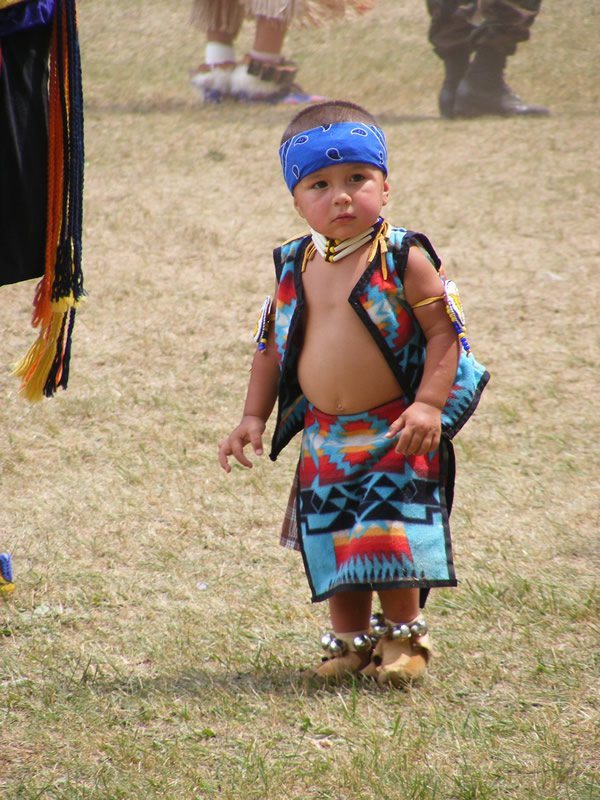 An Ojibwe toddler joins in the celebration at the Indian Bowl in 2014. (courtesy Dean Hall/Lakeland Times)